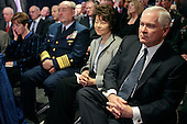 Washington, D.C. - December 20, 2007 -- United States Defense Secretary Robert Gates, right, and Secretary of Labor Elaine L. Chao, 2nd right, attend the ceremonial swearing in of Secretary of Veterans Affairs James Peake at the Department of Veterans Affairs, Thursday, December 20, 2007 in Washington, DC. Having previously served as the Army Surgeon General, Peake succeeds outgoing secretary, James Nicholson, who resigned after coming under scrutiny for the treatment of wounded troopers from the wars in Iraq and Afghanistan. <br /> Credit: Chip Somodevilla - Pool via CNP