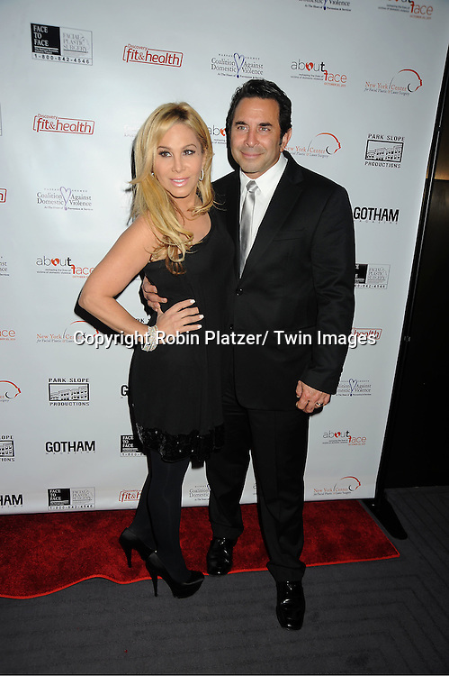 Adrienne Maloof in Julie Brown black dress and husband Dr Paul Nassif attend  The About Face Benefit for Domestic Violence Survivors on October 20, 2011 at the Trump Soho Hotel..in New York City.