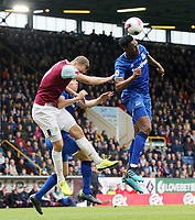 Everton's Yerry Mina heads clear under pressure from Burnley's Chris Wood<br /> <br /> Photographer Rich Linley/CameraSport<br /> <br /> The Premier League - Burnley v Everton - Saturday 5th October 2019 - Turf Moor - Burnley<br /> <br /> World Copyright © 2019 CameraSport. All rights reserved. 43 Linden Ave. Countesthorpe. Leicester. England. LE8 5PG - Tel: +44 (0) 116 277 4147 - admin@camerasport.com - www.camerasport.com