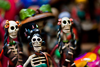 Calaca figurines are sold on the market during the Day of the Dead festivities in Mexico City, Mexico, 28 October 2016. Skulls, skeletons and the other death symbols are used to adorn graves, altars and offerings during the Day of the Dead (Día de Muertos). A syncretic religious holiday, combining the death veneration rituals of the ancient Aztec culture with the Catholic practice, is celebrated throughout all Mexico. Based on the belief that the souls of the departed may come back to this world on that day, people gather at the gravesites in cemeteries, praying, drinking and playing music, to joyfully remember friends or family members who have died and to support their souls on the spiritual journey.