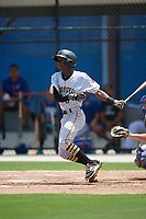 GCL Pirates shortstop Victor Ngoepe (5) follows through on a swing during a game against the GCL Blue Jays on July 20, 2017 at Bobby Mattick Training Center at Englebert Complex in Dunedin, Florida.  GCL Pirates defeated the GCL Blue Jays 11-6 in eleven innings.  (Mike Janes/Four Seam Images)