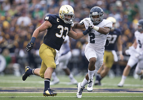 August 30, 2014:  Notre Dame running back Cam McDaniel (33) and Rice cornerback Malcolm Hill (2) runs down field during NCAA Football game action between the Notre Dame Fighting Irish and the Rice Owls at Notre Dame Stadium in South Bend, Indiana.  Notre Dame defeated Rice 48-17.