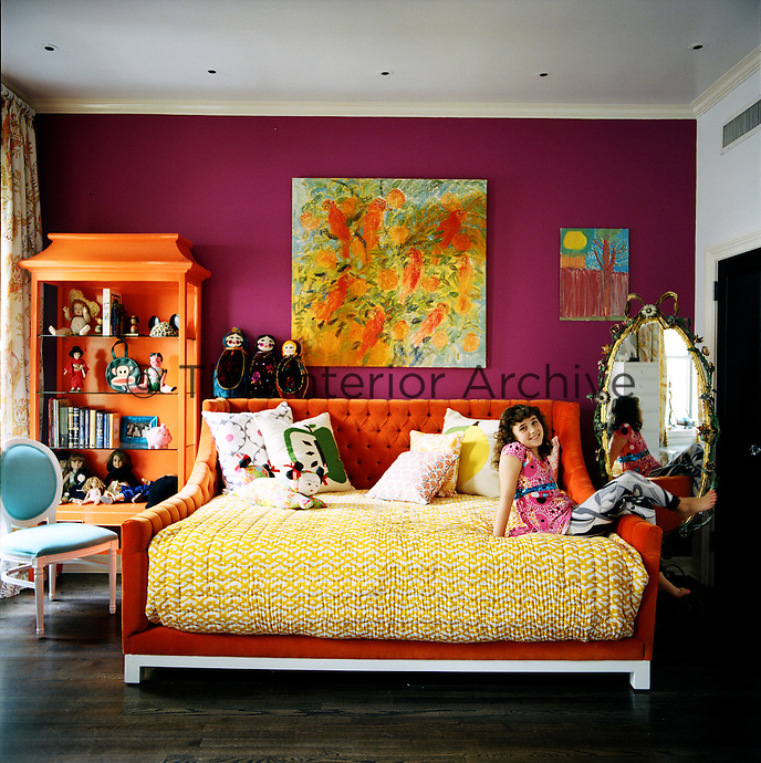 In Nanette Lepore's daughter's bedroom a custom-made bed and open shelving echo the colour of a painting entitled 'Seville Oranges and Lories'