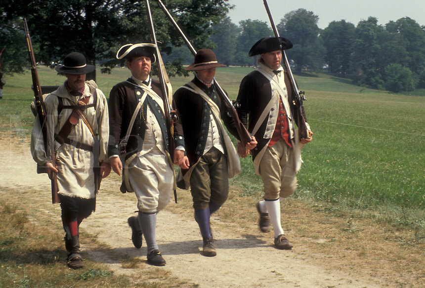 "AJ2774, Valley Forge Park, reenactment, Valley Forge, soldiers, Pennsylvania, Four men dressed in Continental Army soldier costumes march together in the reenactment of the American Revolution at the """"March out of the Continental Army"""" in Valley Forge National Historical Park in Valley Forge in the state of Pennsylvania."