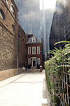 Small historic house overshadowed by modern office blocks, Walbrook, City of London, London