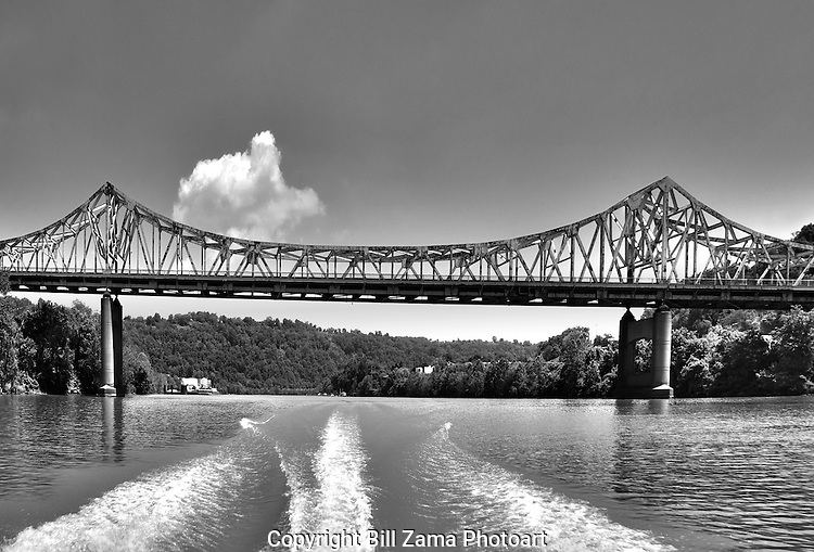 Stern view of boat's wake and one of the many bridges over the Monongahela River in Pittsburgh PA.