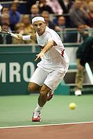 20040220, Rotterdam, ABNAMRO WTT, Roger Federer in actie tegen Henman