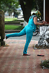 A woman does her morning exercises near the Citadel in Hue, Vietnam. April 22, 2013.