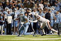 CHAPEL HILL, NC - NOVEMBER 02: Beau Corrales #15 of the University of North Carolina is grabbed by De'Vante Cross #15 during a game between University of Virginia and University of North Carolina at Kenan Memorial Stadium on November 02, 2019 in Chapel Hill, North Carolina.
