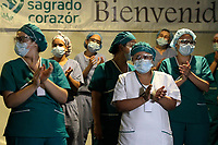 MEDELLIN, COLOMBIA - MAY 12: Nurses watch as soldiers pay tribute to them on International Nurses Day, at the Sagrado Corazón Clinic in Medellín, Colombia, on May 12, 2020. The coronavirus pandemic has claimed more 290,000 lives worldwide, according to a count from official sources. (Photo by Fredy Builes / VIEWpress via Getty Images)
