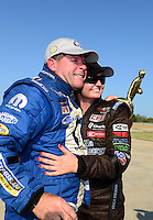 Sept. 23, 2012; Ennis, TX, USA: NHRA pro stock driver Allen Johnson celebrates after winning with runner-up Erica Enders the Fall Nationals at the Texas Motorplex. Mandatory Credit: Mark J. Rebilas-