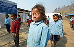 Children line up to begin the day at the Shri Pashupati Praja Primary School in the village of Tanglichowk, in the Gorkha District of Nepal. In the aftermath of the April 2015 earthquake that ravaged Nepal, Dan Church Aid, the ACT Alliance helped people in this village with a variety of services, including latrines, emergency shelter, livelihood projects and school construction.