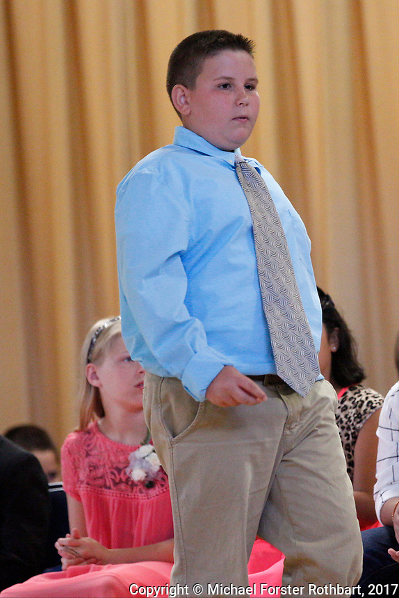 The Oneonta Greater Plains elementary school fifth grade awards ceremony, on June 21, 2017.<br /> &copy; Michael Forster Rothbart Photography<br /> www.mfrphoto.org &bull; 607-267-4893<br /> 34 Spruce St, Oneonta, NY 13820<br /> 86 Three Mile Pond Rd, Vassalboro, ME 04989<br /> info@mfrphoto.org<br /> Photo by: Michael Forster Rothbart<br /> Date:  6/21/2017<br /> File#:  Canon &mdash; Canon EOS 5D Mark III digital camera frame C19284