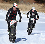 DEADWOOD, SD - JANUARY 23, 2016 -- James Meyer #135 is trailed by Perry Jewett #128 in the men's open fat-tire bike class during the 2016 Snow Jam Points Series at Tomahawk Country Club south of Deadwood, S.D. Saturday. (Photo by Richard Carlson/dakotapress.org)
