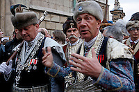 Krakovians dressed in traditional outfits for the nobility in the 1800s march after a memorial mass. Thousands of Krakovians attended the mass at Wawel Castle to honor Polish President Lech Kaczynski. He and many of the country's top leaders were killed in a plane crash Saturday morning on route to the site of a Soviet massacre of Polish officers during World War II. . April 10, 2010