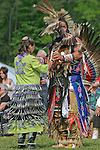 Native Americans in traditional regalia dance at the 8th Annual Redwing PowWow in Virginia Beach, Virginia.
