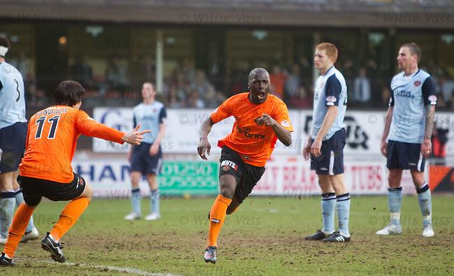 Morgaro Gomis celebrates his goal for Dundee Utd