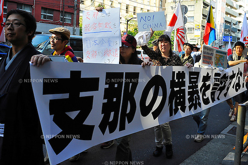 September 29th, 2012 : Tokyo, Japan - Protesters marched against China that its people had had demonstrations against Japan due to the territorial dispute of Senkaku Islands, at Ikebukuro, Toshima, Tokyo, Japan on September 29, 2012. Even though it was the 40th anniversary day of restoration of diplomatic ties between Japan and China, approximately 300 protesters showed up against the country, according to a demonstration authority. (Photo by Koichiro Suzuki/AFLO)