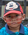 Three-year old Simon Tamakorih Kanamari had his face painted with urucum before a march by indigenous people through the streets of Atalaia do Norte in Brazil's Amazon region on March 27, 2019. They were protesting a central government plan to turn control of health care over to municipalities, in effect destroying a federal program of indigenous health care. Indian rights activists are worried that the government of President Jair Bolsonaro is reducing or eliminating protections for the country's indigenous people.<br /> <br /> Written parental consent obtained.
