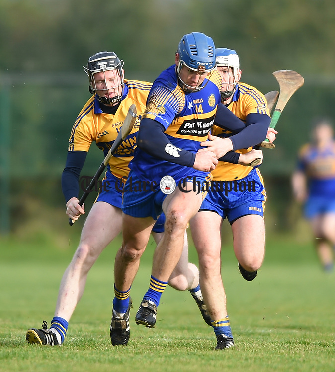 Mike Mc Inerney of  Newmarket  in action against Jamie Shanahan and Aidan Quilligan of  Sixmilebridge during their Clare Champion Cup final at Clonlara. Photograph by John Kelly.