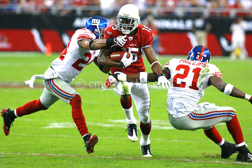 Nov 23, 2008; Glendale, AZ, USA; Arizona Cardinals wide receiver Steve Breaston (15) is tackled by New York Giants cornerback Terrell Thomas (24) and safety Kenny Phillips (21) in the third quarter of a game at University of Phoenix Stadium.  The Giants won the game 37-29.  Mandatory Credit: Chris Morrison-US PRESSWIRE