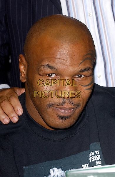 MIKE TYSON .At Big Joe Egan's Autobiograhy Book Signing at Books Etc. Canary Wharf, London, UK..November 17th, 2005.Ref: BEL.headshot portrait mustache facial hair tattoo.www.capitalpictures.com.sales@capitalpictures.com.© Capital Pictures.