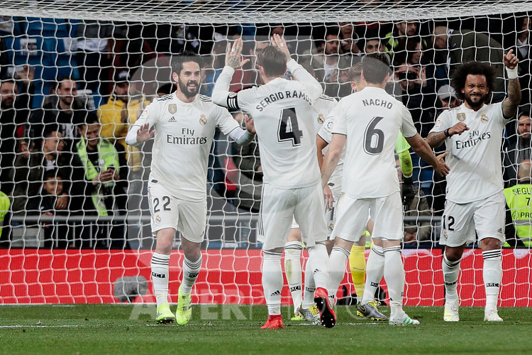 Real Madrid's Francisco Alarcon 'Isco' (L) and Sergio Ramos (R) celebrate goal during La Liga match between Real Madrid and SD Huesca at Santiago Bernabeu Stadium in Madrid, Spain.March 31, 2019. (ALTERPHOTOS/A. Perez Meca)