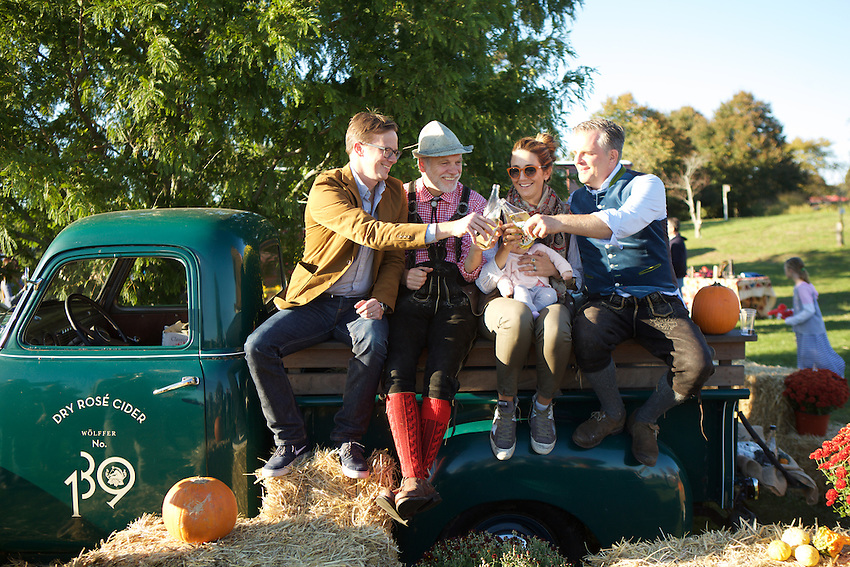 Sagaponack, NY - October 10, 2015: Max Rohn, Roman Roth, Joey Wolffer and Marc Wolffer toast a successful Harvest Festival at Wolffer Estate Vineyard.<br /> <br /> CREDIT: Clay Williams.<br /> <br /> &copy; Clay Williams / claywilliamsphoto.com