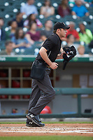 Home plate umpire Skyler Shown works the International League game between the Louisville Bats and the Charlotte Hornets at BB&T BallPark on June 22, 2019 in Charlotte, North Carolina. The Hornets defeated the Bats 7-6. (Brian Westerholt/Four Seam Images)