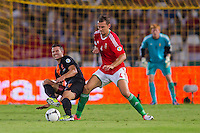 Netherlands' Robin van Persie (L) and Hungary's Roland Juhasz (R) fight for the ball during a World Cup 2014 qualifying soccer match Hungary playing against Netherlands in Budapest, Hungary on September 11, 2012. ATTILA VOLGYI