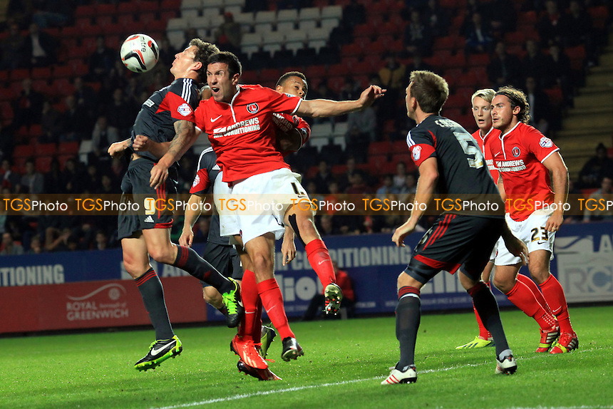 Darius Henderson of Nottingham Forest controls the ball on his chest under pressure from the Charlton defence - Charlton Athletic vs Nottingham Forest - Sky Bet Championship Football at The Valley, London - 01/10/13 - MANDATORY CREDIT: Paul Dennis/TGSPHOTO - Self billing applies where appropriate - 0845 094 6026 - contact@tgsphoto.co.uk - NO UNPAID USE