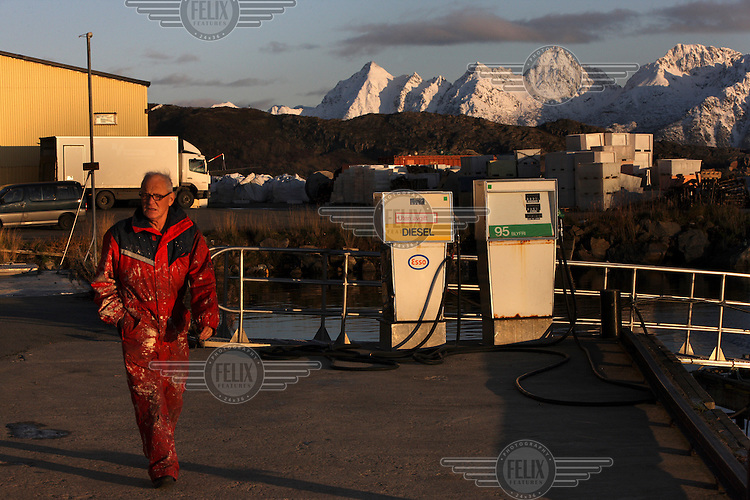 A man at a gas station in Svolvaer.