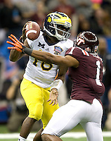 Antone Exum of Virginia Tech sacks Michigan quarterback Denard Robinson during Sugar Bowl game at Mercedes-Benz SuperDome in New Orleans, Louisiana on January 3rd, 2012.  Michigan defeated Virginia Tech, 23-20 in first overtime.