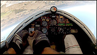 BNPS.co.uk (01202 558833)<br /> Pic:  BobGrimstead/BNPS<br /> <br /> Footage from inside the cockpit of the tiny jet.<br /> <br /> My other planes a 747...!<br /> <br /> Former British Airways pilot Bob Grimstead(70) gets to grips with the worlds smallest twin jet aircraft.<br /> <br /> These remarkable photos capture the world's smallest twin-jet which resembles a 'bubble car on wings' taking to the skies.<br /> <br /> British pilot Bob Grimstead, 70, reached speeds of up to 140mph and climbed to 5,000ft in the Colomban Jet Cri-Cri.<br /> <br /> His wife Karen, 62, was in an aircraft next to him to take these snaps as he indulged in some aerial acrobatics, including several loops and rolls and a dramatic dive.<br /> <br /> The jet, which is almost entirely made of aluminium, is just 13ft long, 4ft wide and has a wingspan of 17ft, while weighing in at a paltry 180lb.<br /> <br /> Mr Grimstead, who lives in Sussex, has flown aircraft for 50 years and worked as a commercial pilot. He flew enormous Boeing 747s, which are at the complete opposite end of the size spectrum, weighing 400 tonnes when full of passengers and measuring 230ft in length, with a 210ft wingspan and a cabin width of 20ft.