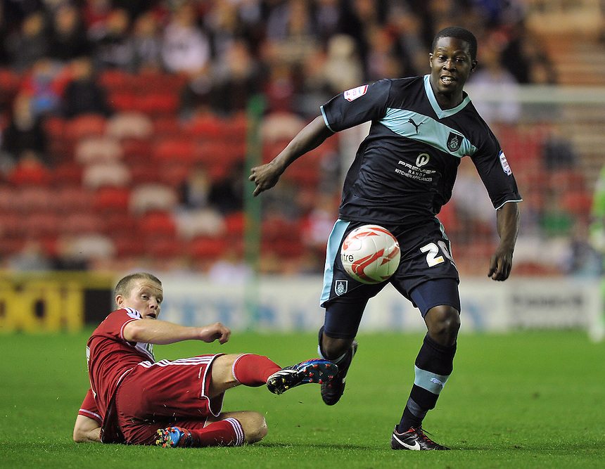 Burnley's Marvin Bartley  is fouled..Football - npower Football League Championship - Middlesbrough v Burnley - Tuesday 21st August 2012 - Riverside Stadium - Middlesbrough..