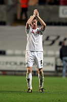 ATTENTION SPORTS PICTURE DESK<br /> Pictured: Alan Tate of Swansea thanks team supporters after the end of the game<br /> Re: npower Championship, Swansea City FC v Bristol City Football Club at the Liberty Stadium, south Wales. Wednesday 10 November 2010