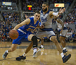 South Dakota State guard Owen King (23) drives against Nevada's Cody Martin (11) in the scond half of an NCAA college basketball game in Reno, Nev., Saturday, Dec. 15, 2018. (AP Photo/Tom R. Smedes)