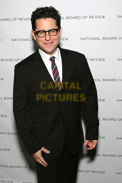 JJ ABRAMS .National Board of Review of Motion Picture Awards Gala held at Cipriani 42nd Street, New York, NY, USA, .12th January 2010. .half length glasses blue striped black suit tie white shirt J.J..CAP/LNC/TOM.©LNC/Capital Pictures.