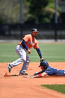 Houston Astros Alex Hernandez (65) can not come up with the throw as Stephen Gaylor (38) slides in during a minor league spring training game against the Atlanta Braves on March 29, 2015 at the Osceola County Stadium Complex in Kissimmee, Florida.  (Mike Janes/Four Seam Images)