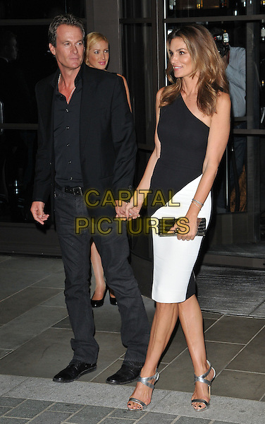 Rande Gerber &amp; Cindy Crawford attend the Cindy Crawford &quot;Becoming&quot; book &amp; Casamigos Tequila launch party, The Beaumont, Balderton Street, London, England, UK, on Thursday 01 October 2015. <br /> CAP/CAN<br /> &copy;Can Nguyen/Capital Pictures