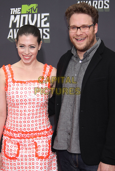 Lauren Miller & Seth Rogen.2013 MTV Movie Awards - Arrivals held at Sony Pictures Studios, Culver City, California, USA..14th April 2013.half length  black grey gray shirt glasses beard facial hair suit jacket red orange white print dress couple married husband wife .CAP/ADM/RE.©Russ Elliot/AdMedia/Capital Pictures.
