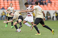 Houston, TX - Friday December 11, 2016: Brian Nana-Sinkam (8) of the Stanford Cardinal races past Jon Bakero (7) of the Wake Forest Demon Deacons at the NCAA Men's Soccer Finals at BBVA Compass Stadium in Houston Texas.