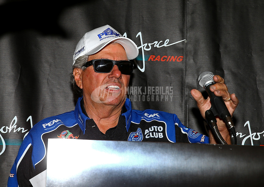 Nov 1, 2014; Las Vegas, NV, USA; NHRA funny car driver John Force speaks during a press conference to announce Peak Antifreeze as his new sponsor for 2015 during qualifying for the Toyota Nationals at The Strip at Las Vegas Motor Speedway. Mandatory Credit: Mark J. Rebilas-USA TODAY Sports