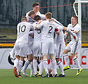 Raith Rovers' Callum Booth (hidden) is mobbed by team mates after he scores their goal.