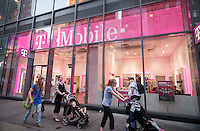 A T-Mobile USA store is seen in Times Square in New York on Tuesday, June 16, 2015. (© Richard B. Levine)