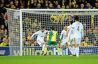 With Swansea City Goalkeeper Lukasz Fabianski out of position, Gylfi Sigurosson is unable to stop the shot of Jonny Howson of Norwich City for the opening goal, 1-0, during the Barclays Premier League match between Norwich City and Swansea City played at Carrow Road, Norwich on November 7th 2015