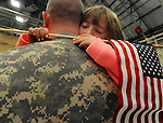 Ashley Nowakowski, 8, of Colchester,  hugs her father Major Stephan Nowakowski, during a deployment send off ceremony at the Connecticut National Guard base, Tuesday, March 7, 2015.  in Windsor Locks. Ninety members of the 1st Battalion, 169th Aviation Regiment, will be deploying to Kosovo where they will provide aerial medical evacuation, transportation support and fuel testing, the Connecticut Army National Guard said. (Jim Michaud / Journal Inquirer)