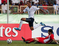 Stefan Jerome jumps over his defender. US Under-17 Men's National Team defeated United Arab Emirates 1-0 at Gateway International  Stadium in Ijebu-Ode, Nigeria on November 1, 2009.