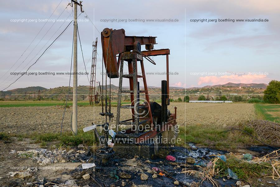 ALBANIA, Fier, crude oil field and drilling pump from communist era, still operating and polluting the environment / ALBANIEN, Fier, Erdoelfoerderung, alte Oelfoerderpumpe