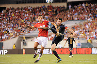 Danny Califf (4) of the Philadelphia Union plays the ball away from Dimitar Berbatov (9) of Manchester United. Manchester United (EPL) defeated the Philadelphia Union (MLS) 1-0 during an international friendly at Lincoln Financial Field in Philadelphia, PA, on July 21, 2010.